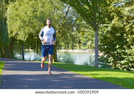 Full length shot of a young man running outdoors.