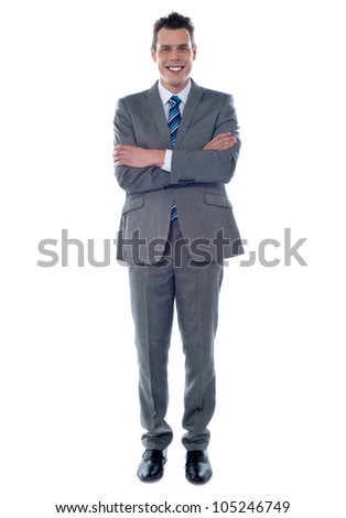 Full length shot of an entrepreneur standing with crossed arms and smiling at camera - stock photo