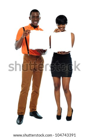 Full length shot of attractive african couple with pizza boxes