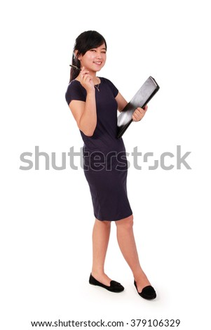Full length shot of cheerful female Asian office worker posing with document keeper, isolated on white background - stock photo
