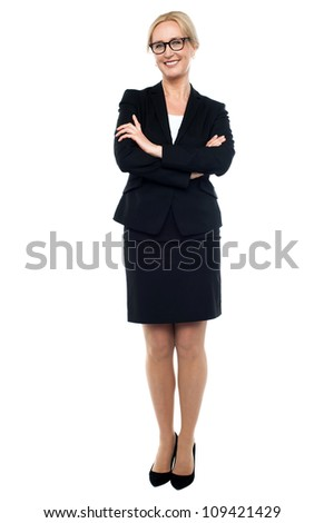 Full length shot of confident female manager posing with crossed arms - stock photo