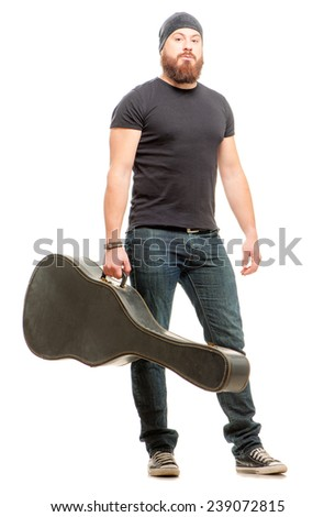 Full length shot of confident young bearded man holding guitar case over white background - stock photo