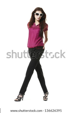 full length shot of fashion model wearing sunglasses on white background - stock photo