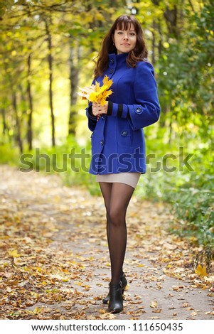 Full length shot of girl  in autumn - stock photo