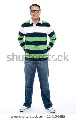 Full length shot of handsome casual male model posing with hands in back pocket of his jeans - stock photo