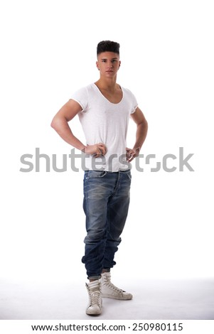 Full length shot of trendy young man standing isolated on white background