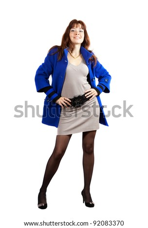 full length shot of woman in blue coat on white background - stock photo