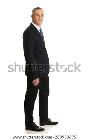 Full length side view businessman with hand in pocket. - stock photo