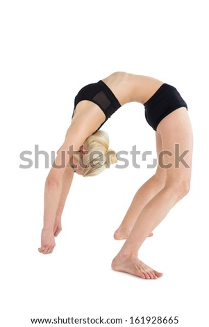 Full length side view of a fit young woman bending backwards over white background - stock photo