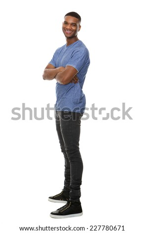 Full length side view portrait of a cheerful african american man - stock photo