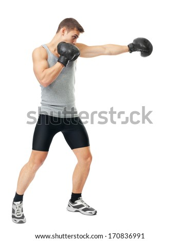 Full length side view portrait of young boxer making punch isolated on white background - stock photo