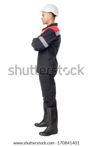 Full length side view portrait of young worker isolated on white background - stock photo