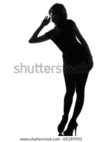 full length silhouette in shadow of a young curious listening woman  in studio on white background isolated