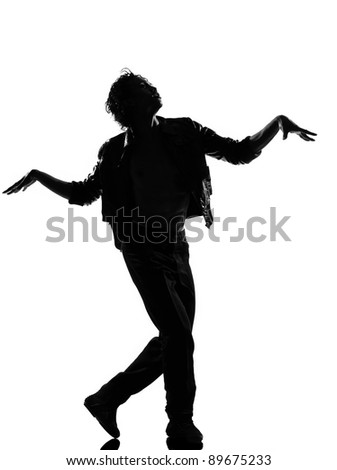 full length silhouette of a young man dancer dancing funky hip hop r&b zombie walk on  isolated  studio white background - stock photo