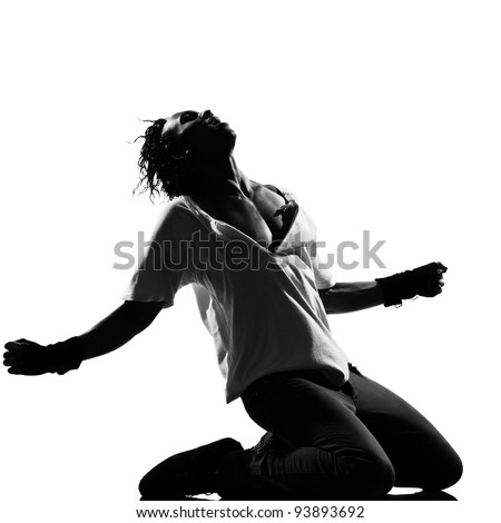 full length silhouette of a young man dancer dancing kneeling screaming funky hip hop r&b on  isolated  studio white background - stock photo