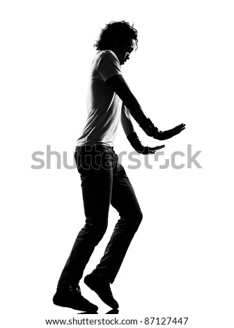 full length silhouette of a young man dancer moonwalk dancing funky hip hop r&b on  isolated  studio white background - stock photo