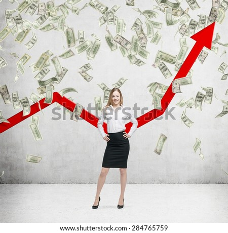 Full-length smiling business lady stands among falling dollar bills from the ceiling. Red arrow is going up as a symbol of the growth in economy. Concrete background. - stock photo