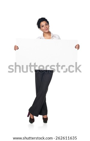 Full length smiling business woman holding blank white board, isolated on white background - stock photo