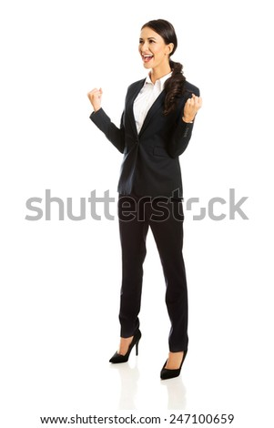 Full length smiling cheerful businesswoman - stock photo