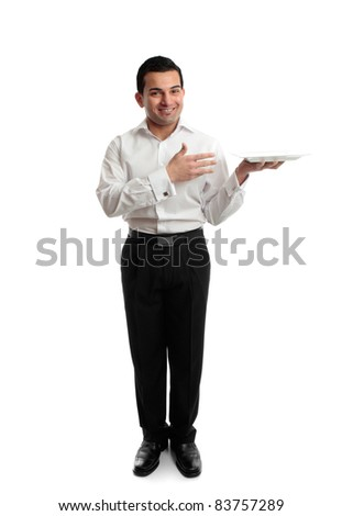 Full length smiling male hospitality worker presenting or carrying a white plate. - stock photo