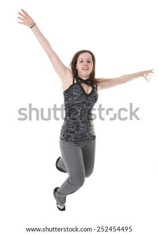 Full length studio photo of attractive woman jumping in air with arms extended. White background. - stock photo