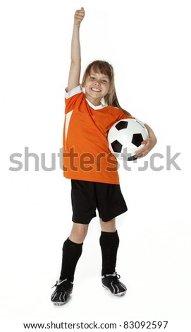 Full length studio photo of cute female child standing holding a soccer ball. - stock photo