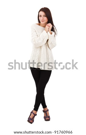 Full length studio photo of pretty young woman standing, looking at camera. White background.