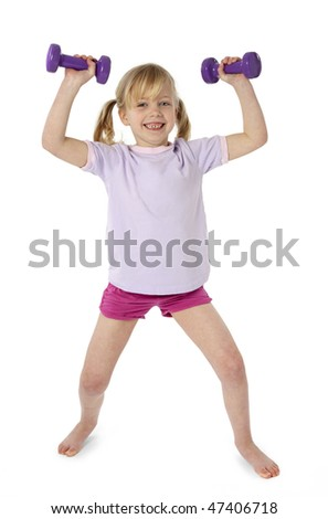 Full length studio photo of 6 year old girl exercising with dumbbells. White background. - stock photo