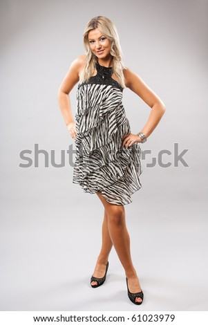 Full length studio portrait of a beautiful blond woman