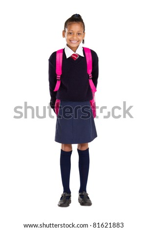 full length studio portrait of female elementary pupil - stock photo