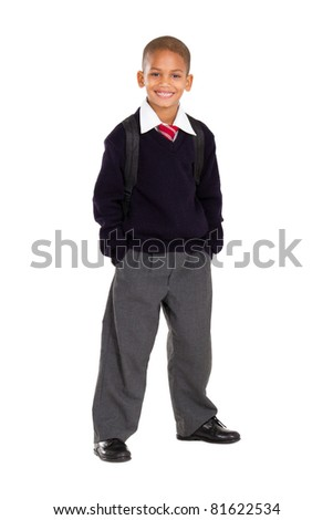 full length studio portrait of male elementary pupil on white - stock photo