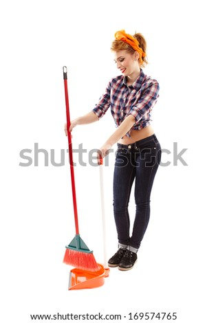 Full length studio portrait of sexy housewife sweeping the floor, isolated over white background