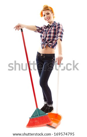Full length studio portrait of sexy housewife with broom and dustpan, isolated over white background - stock photo