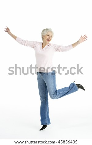 Full Length Studio Portrait Of Smiling Senior Woman - stock photo