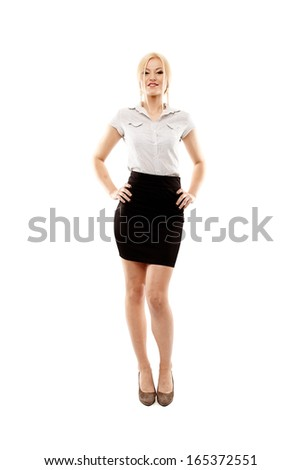 Full length studio portrait of young successful businesswoman standing akimbo, isolated over white background