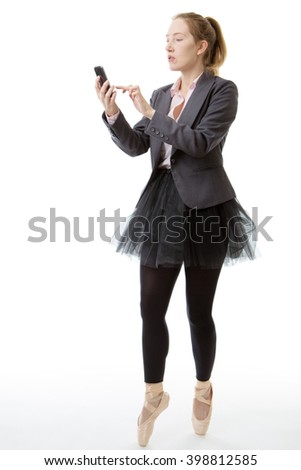 Full length studio shot of a business ballerina en pointe with a mobile phone out infornt of her.  isolated on white - stock photo