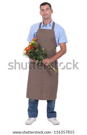 Full length studio shot of a male florist - stock photo