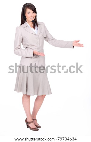 Full length studio shot of a woman with a headset - stock photo