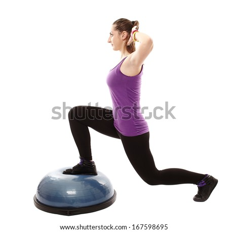 Full length studio shot of athletic woman working out her legs on a bosu bal, isolated over white background - stock photo