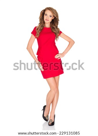Full Length Studio Shot of Attractive Blond Young Woman in Simple Red Fashion Attire  Isolated on White Background. - stock photo