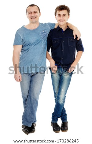 Full length studio shot of happy father and son, isolated over white background - stock photo