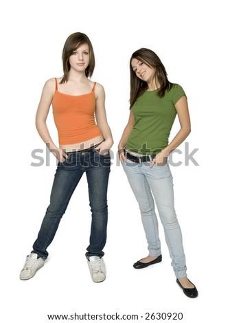 full length studio shot of two trendy teen girls - stock photo