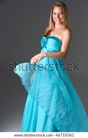 Full Length Studio Shot Of Young Woman In Blue Evening Dress - stock photo