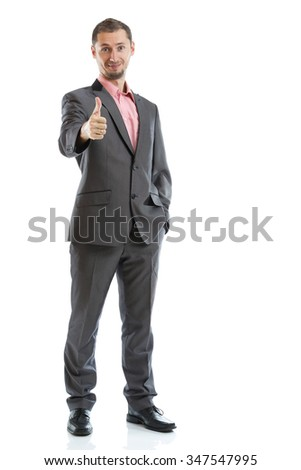 Full length suit tie businessman with thumb up isolated
