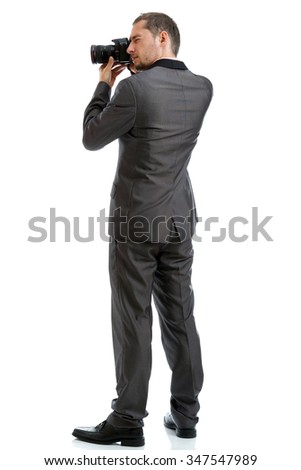 Full length suit tie photographer with camera isolated