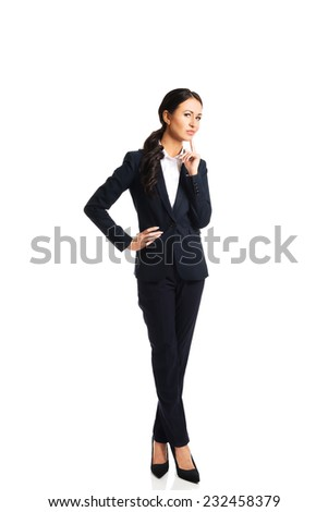 Full length thoughtful businesswoman with a finger under chin. - stock photo