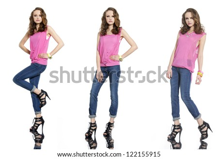 full length three young woman in jeans posing on white background