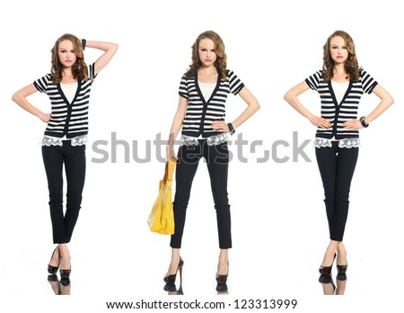full length three young woman in stripy shirt with bag posing at studio - stock photo