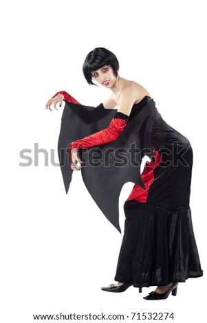 Full length view of a sexy vampire woman standing in a weird position. Isolated on pure white background. - stock photo
