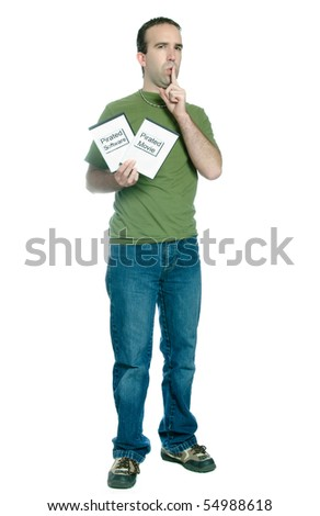 Full length view of a young man holding 2 dvd cases of bootlegged movies and software, isolated against a white background. - stock photo